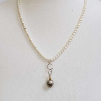 White pearls with Ruthenium Saturn Bead Necklace