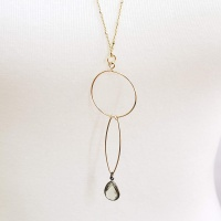 Long gold sparkle necklace with green crystal