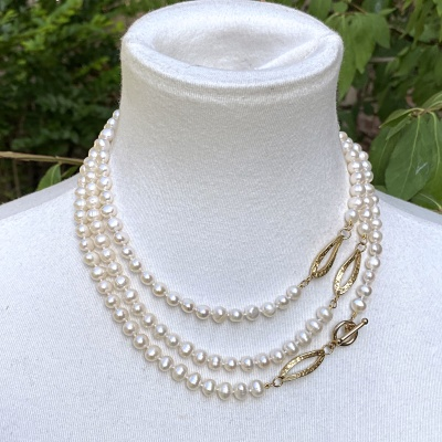 Very long white pearl necklace